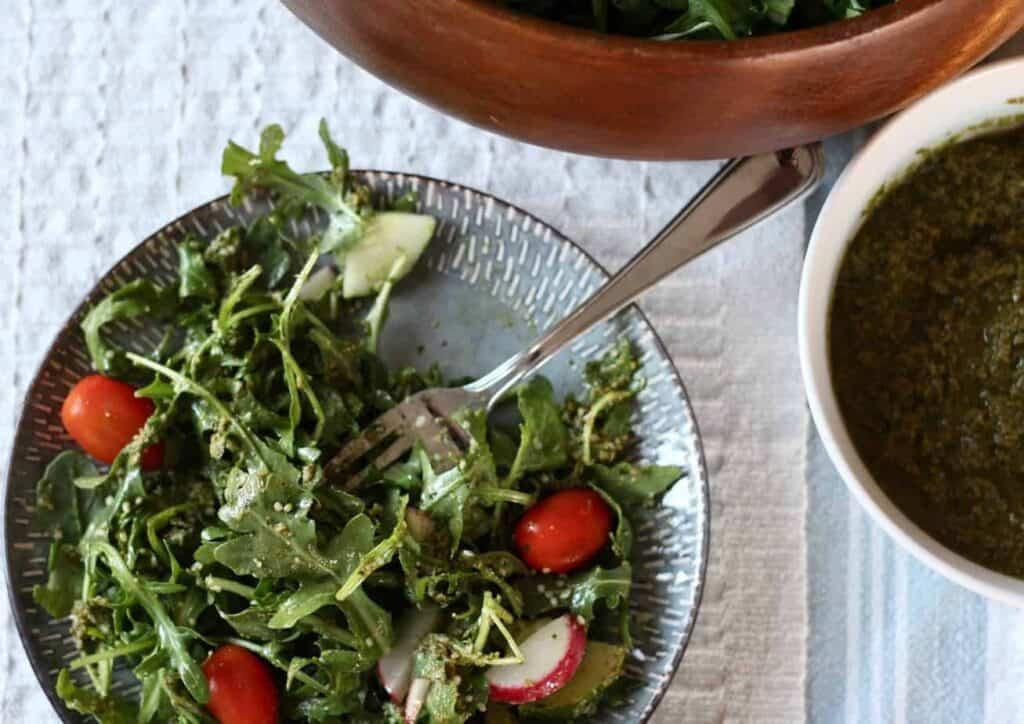 vegan pesto served on an arugula salad
