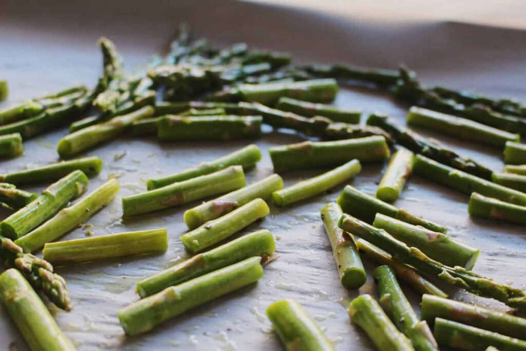 asparagus on baking sheet for roasted winter salad