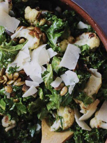 autumn kale salad with pumpkin vinaigrette in bowl