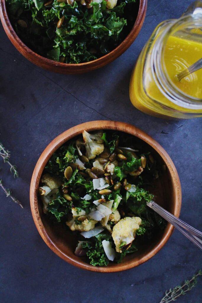 servings of autumn kale salad with pumpkin vinaigrette