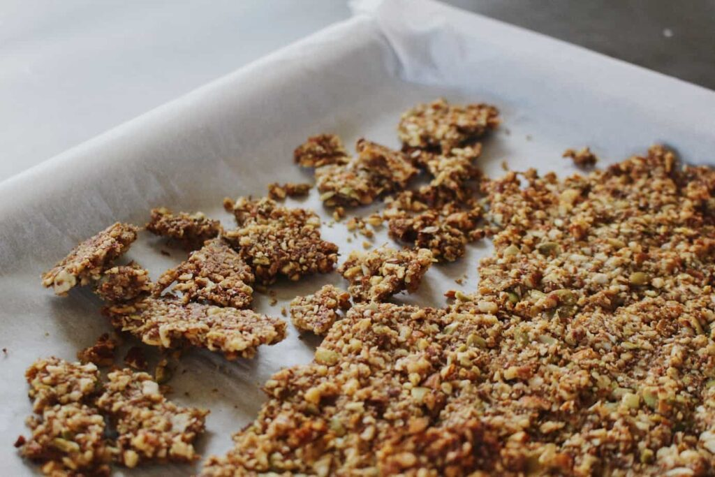 grain-free pumpkin granola crumbled on sheet pan