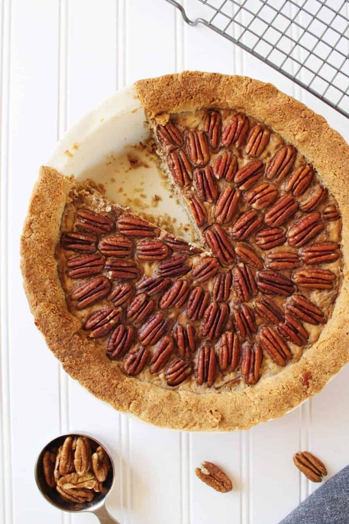 overhead of keto pecan pie with slice cut out