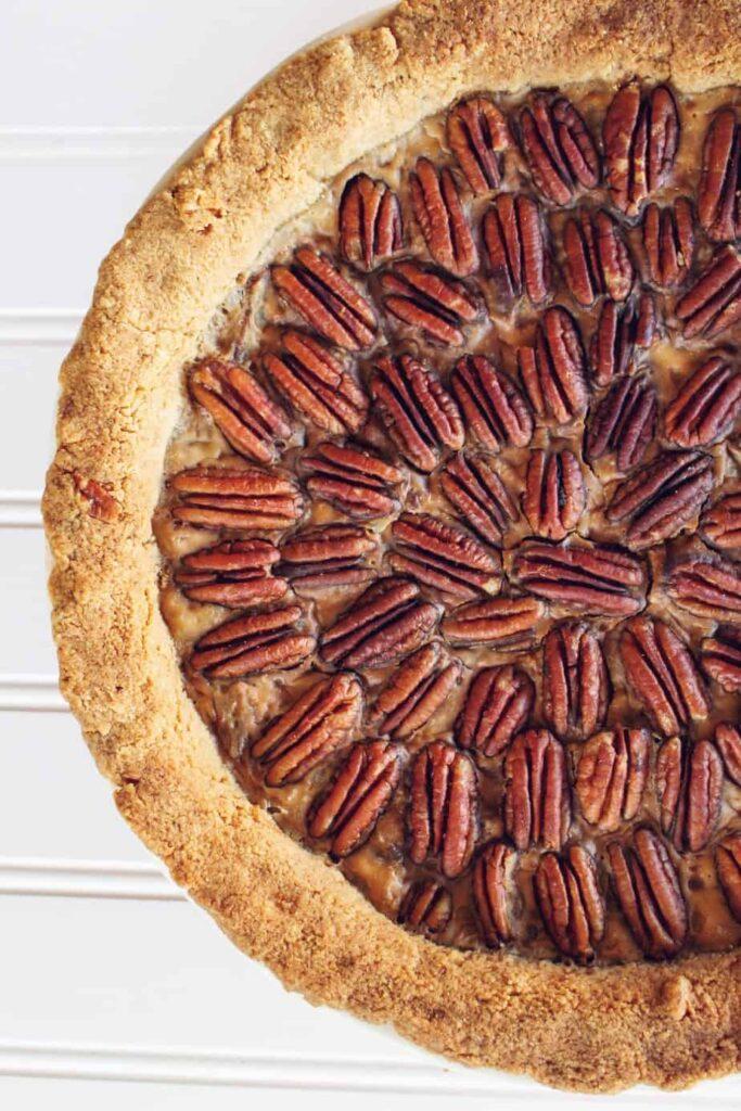 overhead half shot of baked keto pecan pie