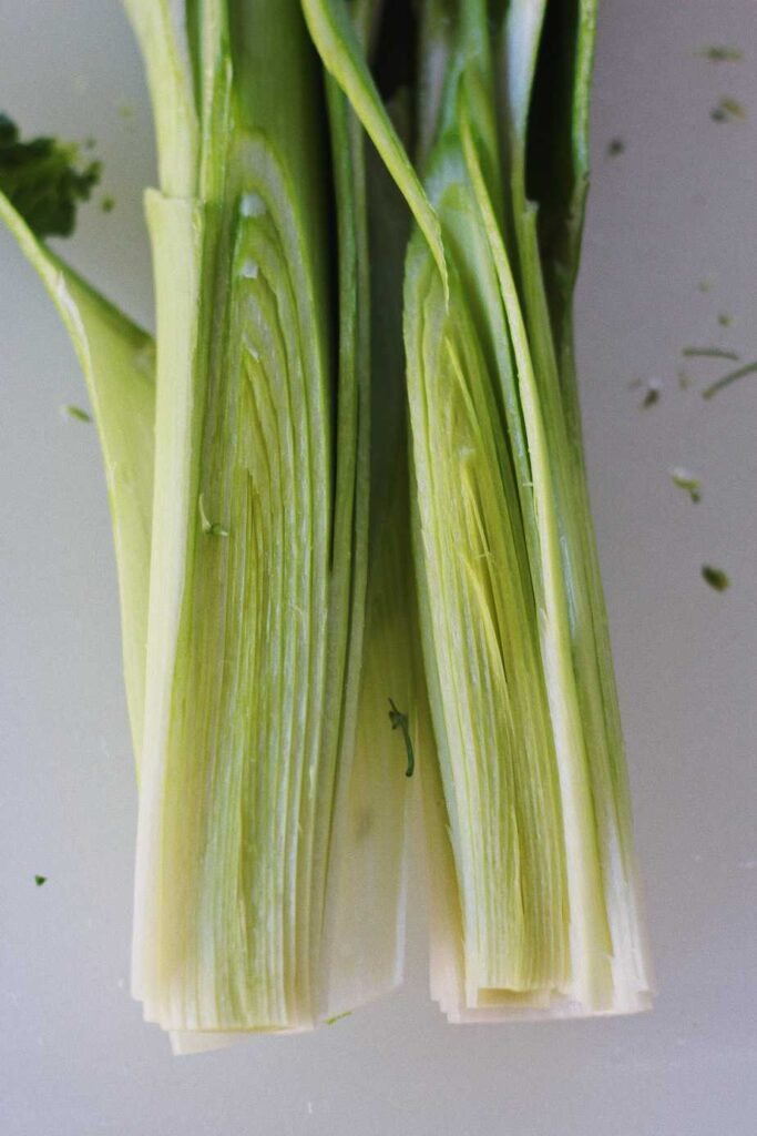 leeks split in half for roasted winter salad