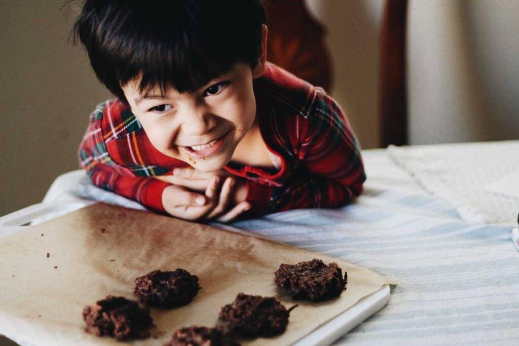 Maverick at table above no-bake chocolate cookies