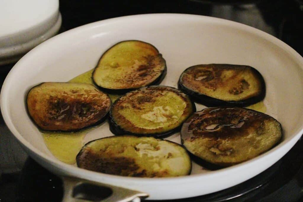 shot of eggplant frying in a pan with olive oil for turkish eggplant casserole