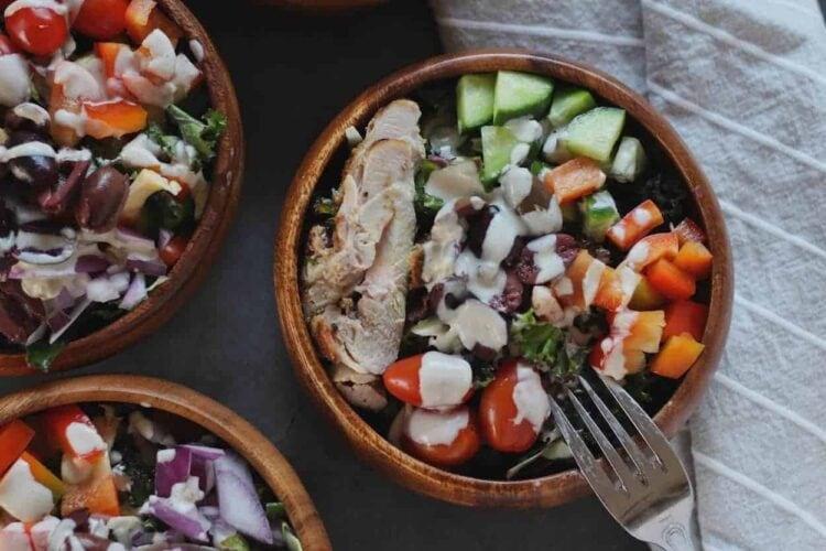 closeup of kale greek salad with garlic tahini dressing