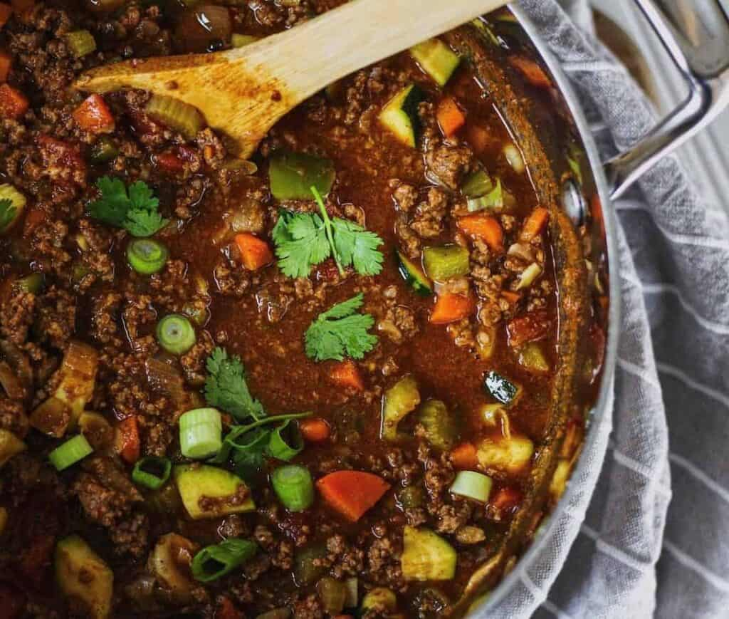 keto chili in a pot with a spoon and linen