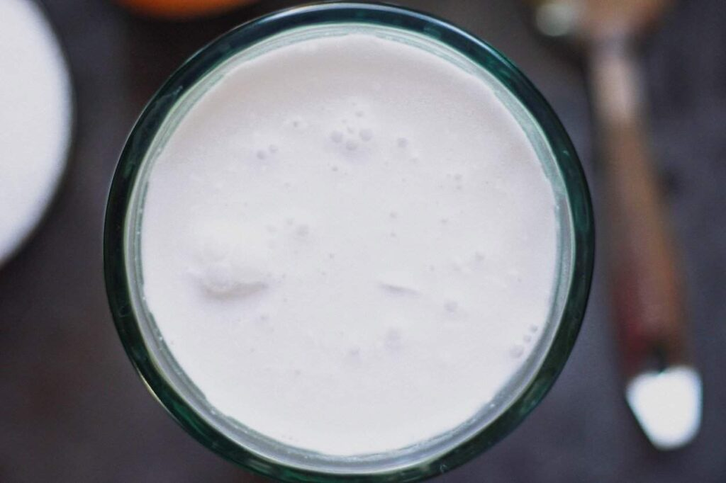 coconut milk in a glass for keto hot chocolate