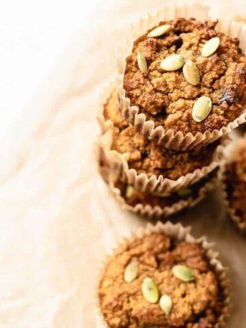 pumpkin almond flour muffins stacked