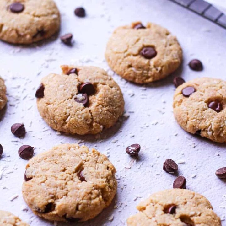 coconut chocolate chip tahini cookies with baking rack in the background