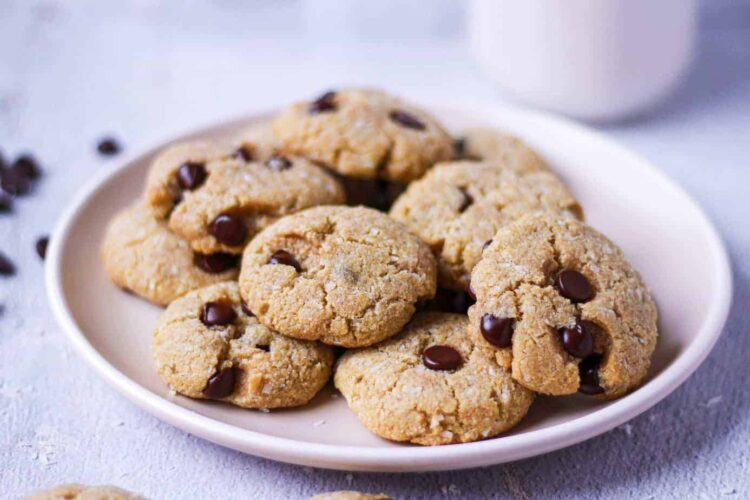closeup shot of coconut chocolate chip tahini cookies on a plate