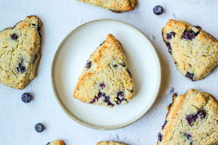 lemon blueberry scones set around a plate