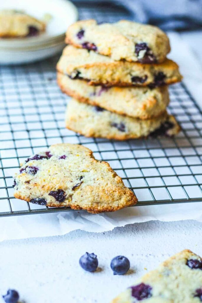 lemon blueberry scones stacked on a cooling rack