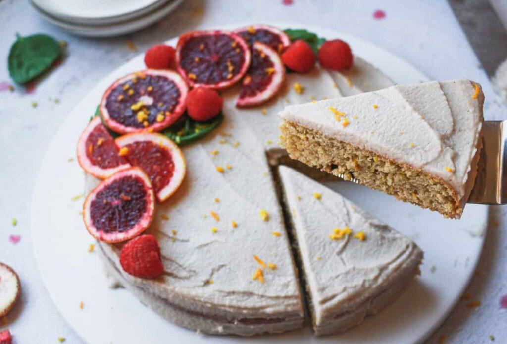 slice of blood orange almond cake with cashew buttercream