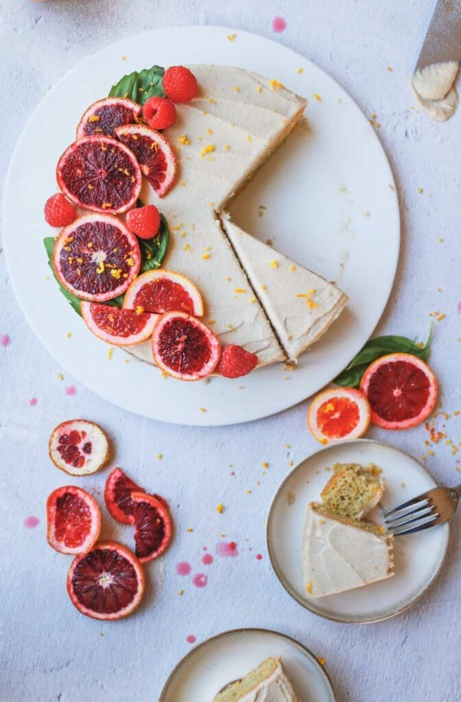 blood orange almond cake with cashew buttercream being served