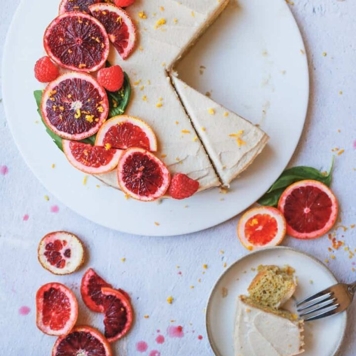 blood orange almond cake with cashew buttercream being served