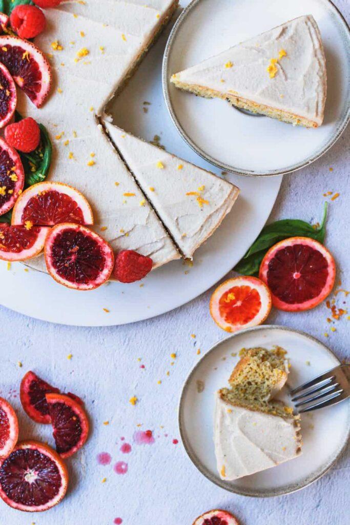 overhead of blood orange almond cake slices on plates