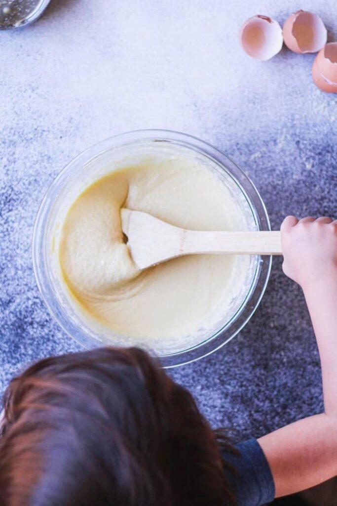 little girl mixing almond flour pancake batter