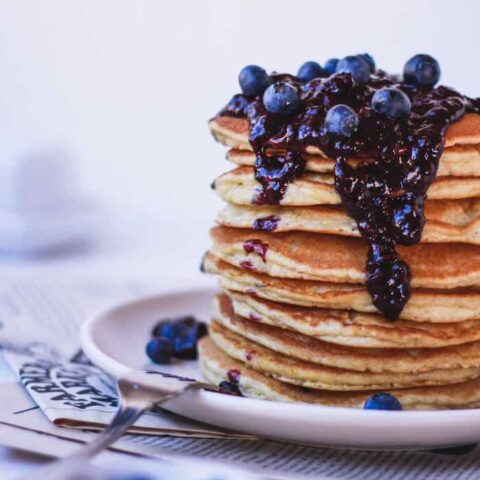 stack of almond flour pancakes with blueberry sauce