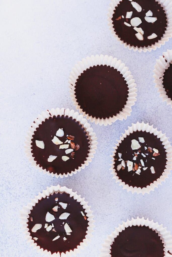 overhead shot of dark chocolate almond butter cups
