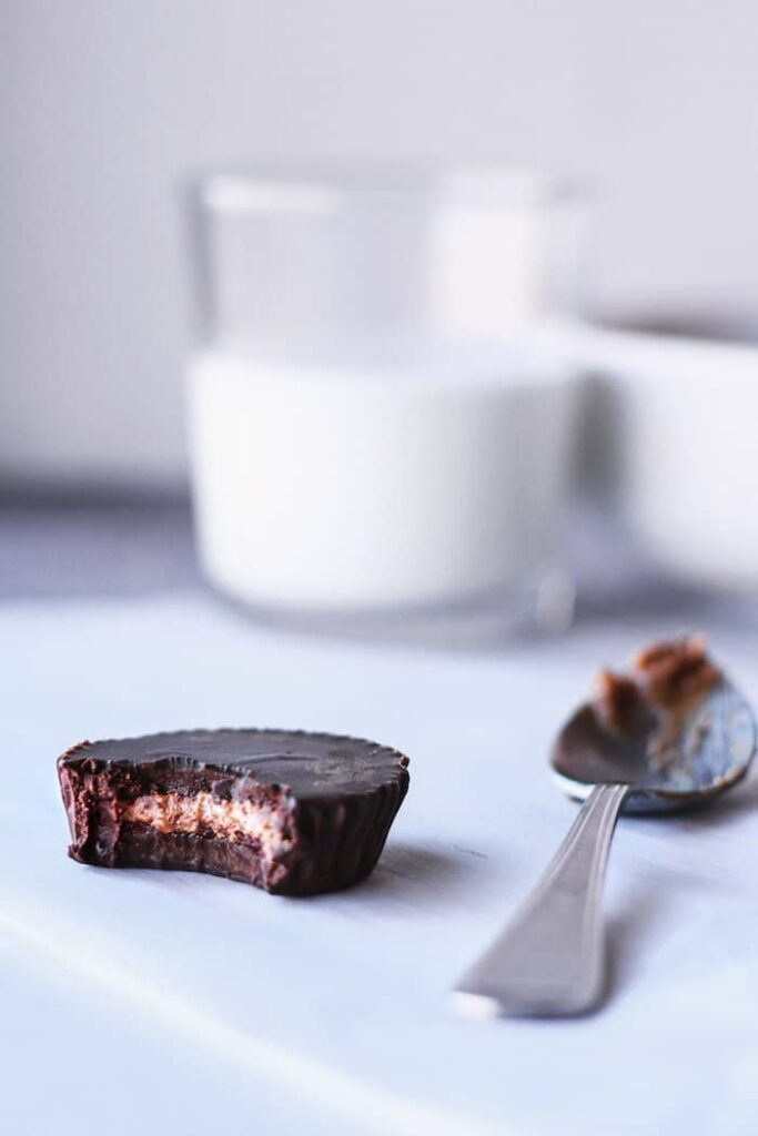 dark chocolate keto almond butter cups with a spoon
