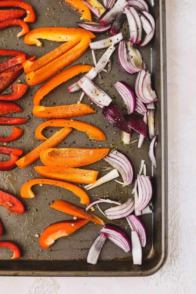 overhead of roasted vegetables on a baking sheet