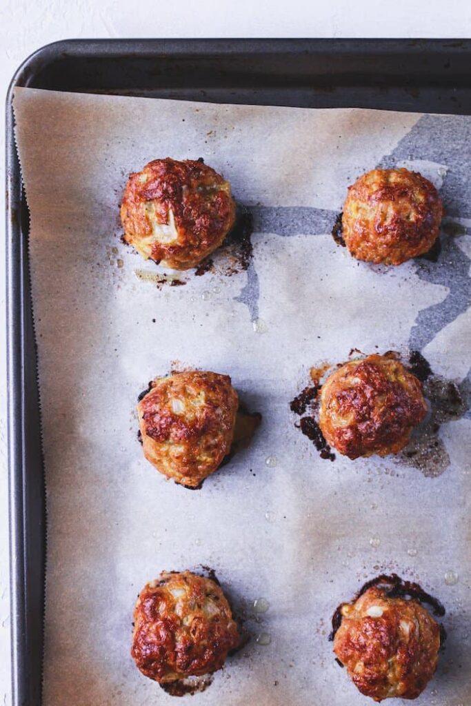 shot of keto teriyaki chicken meatballs on a baking sheet