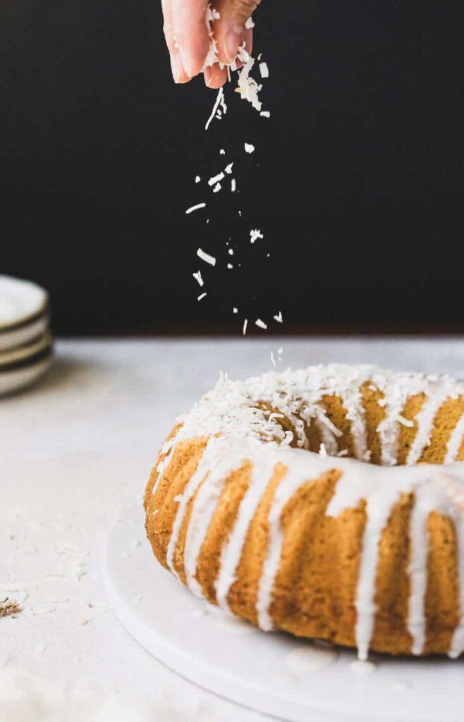 coconut sprinkled on keto coconut cake