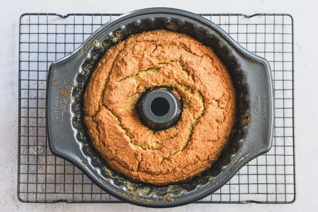 keto coconut cake out of oven, cooling in bundt pan
