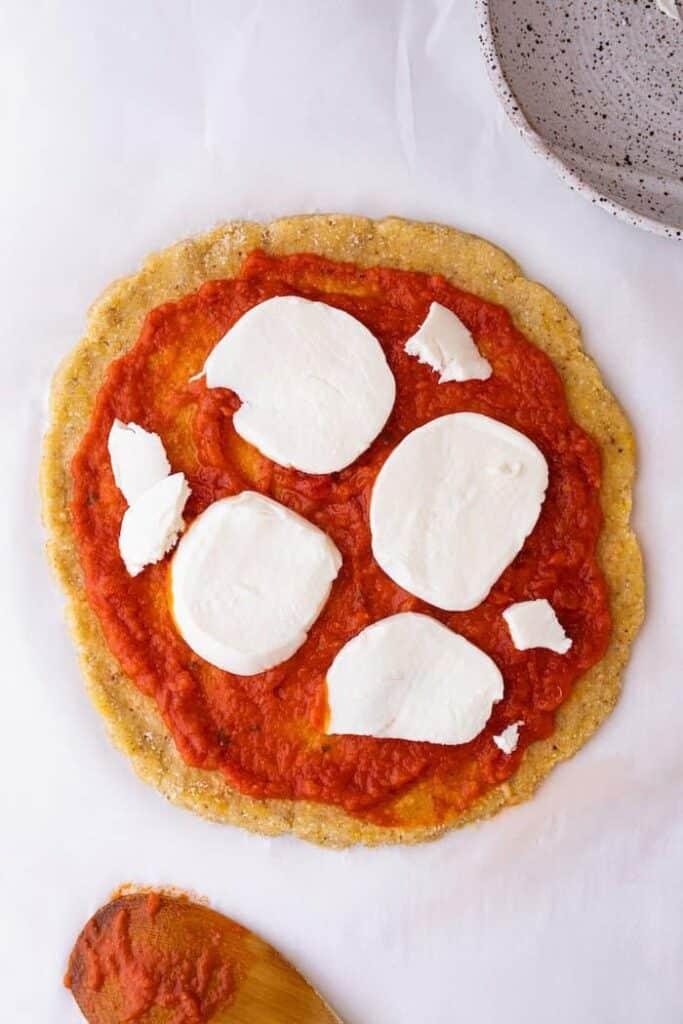 mozzarella on pre-baked keto pizza