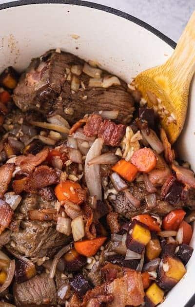 chuck roast and veggies in Dutch oven