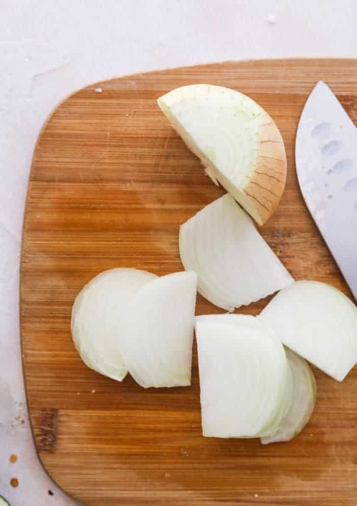 onion on chopping board with a knife