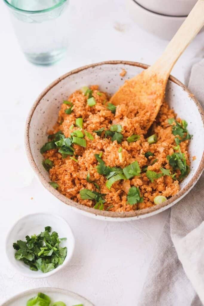spanish cauliflower rice in a bowl with cilantro