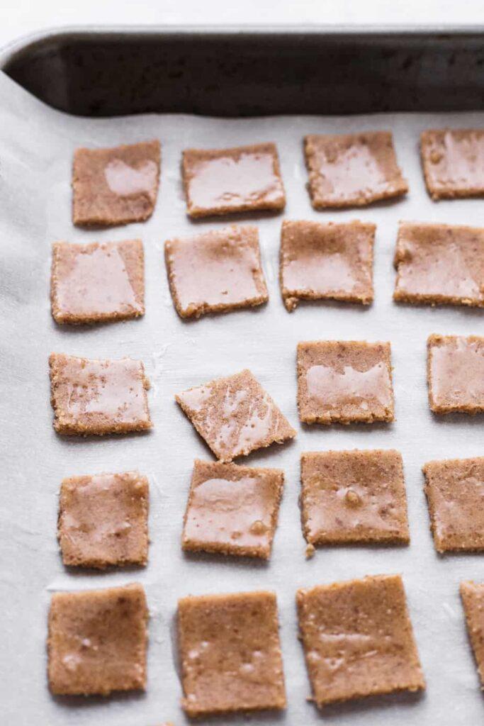 keto cinnamon toast crunch squares on a baking sheet