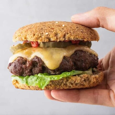 closeup of holding a low-carb burger