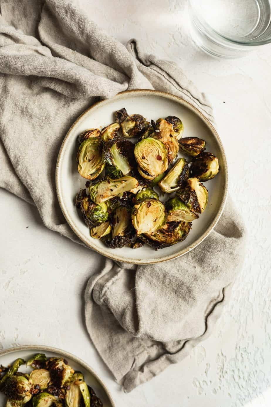 plate of air fryer brussels sprouts keto with a beige linen napkin