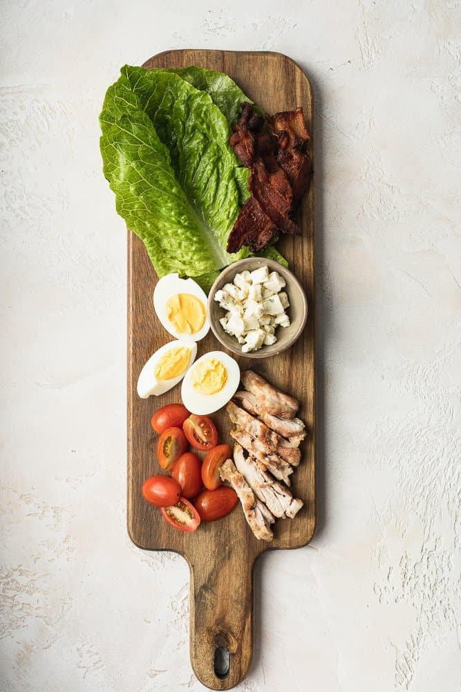 keto Cobb salad ingredients on a wood board