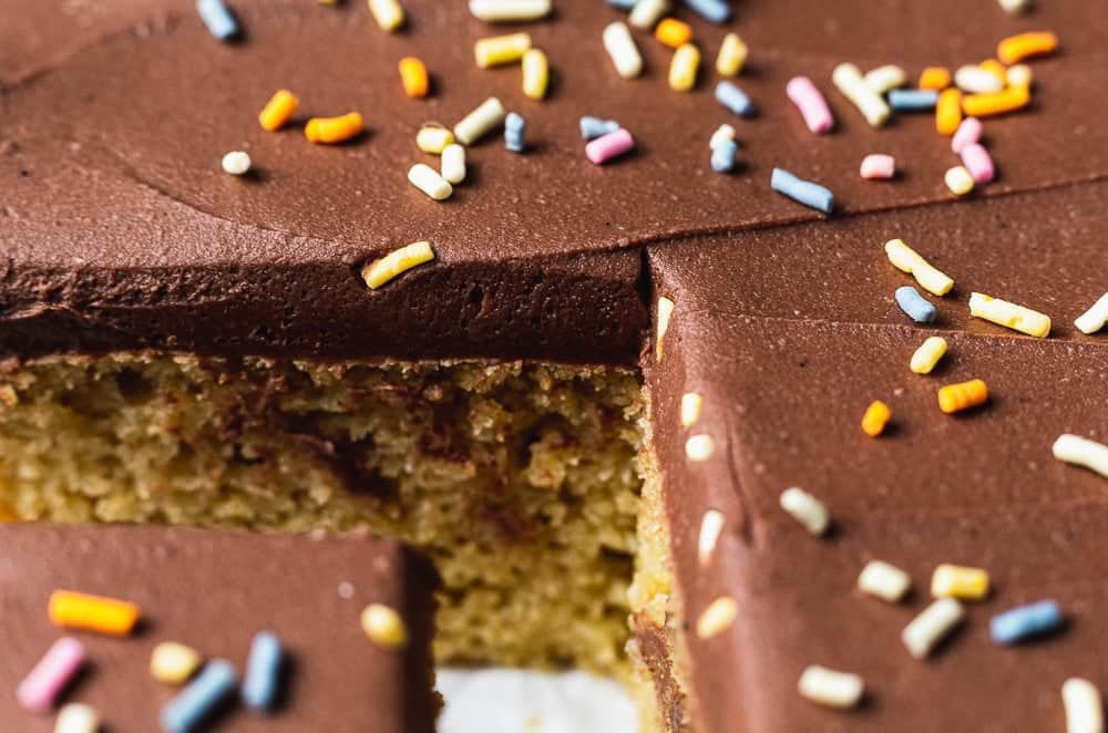closeup of keto chocolate frosting with sprinkles