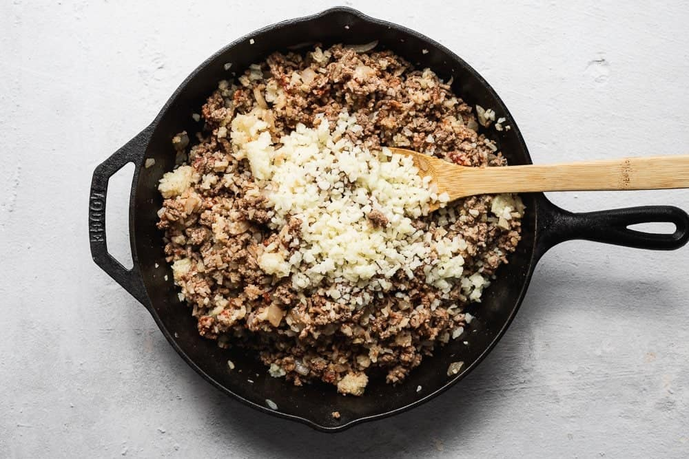 mixing the meat with cauliflower rice