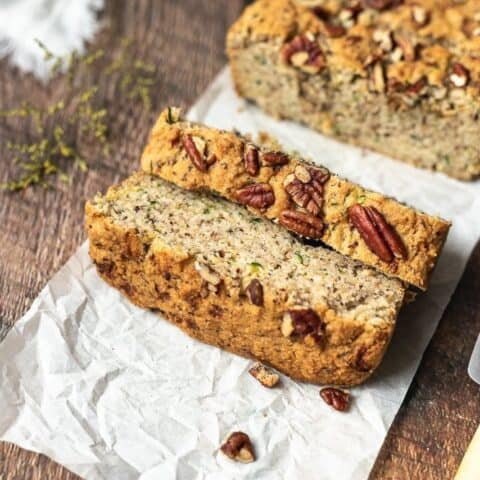 closeups of slices of keto zucchini bread with pecans