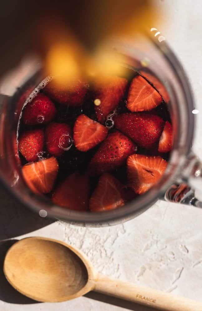 squeezing orange juice into low-carb red sangria