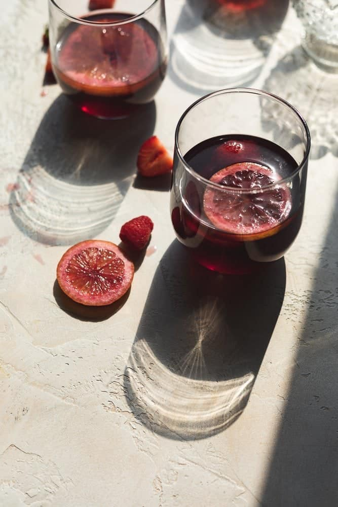 glasses of low-carb sangria with shadows from glass