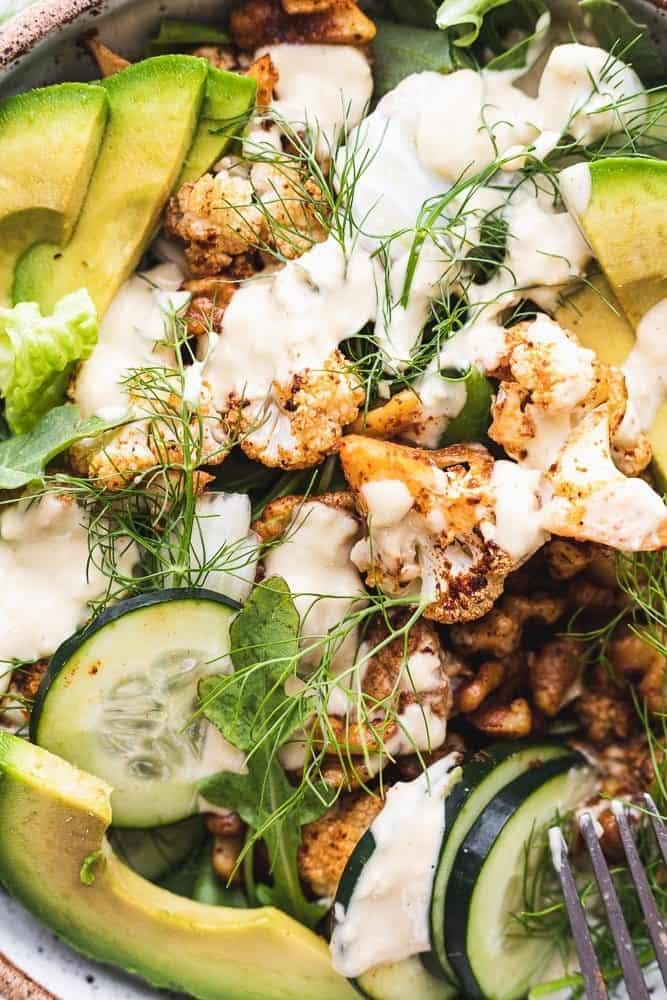 roasted cauliflower salad with citrus tahini dressing closeup