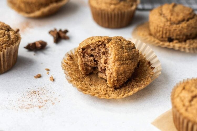 shot of a bite taken out of a keto cinnamon muffin