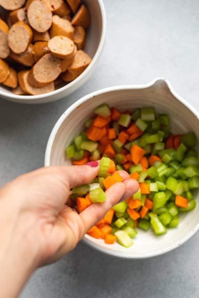pouring veggies into bowl