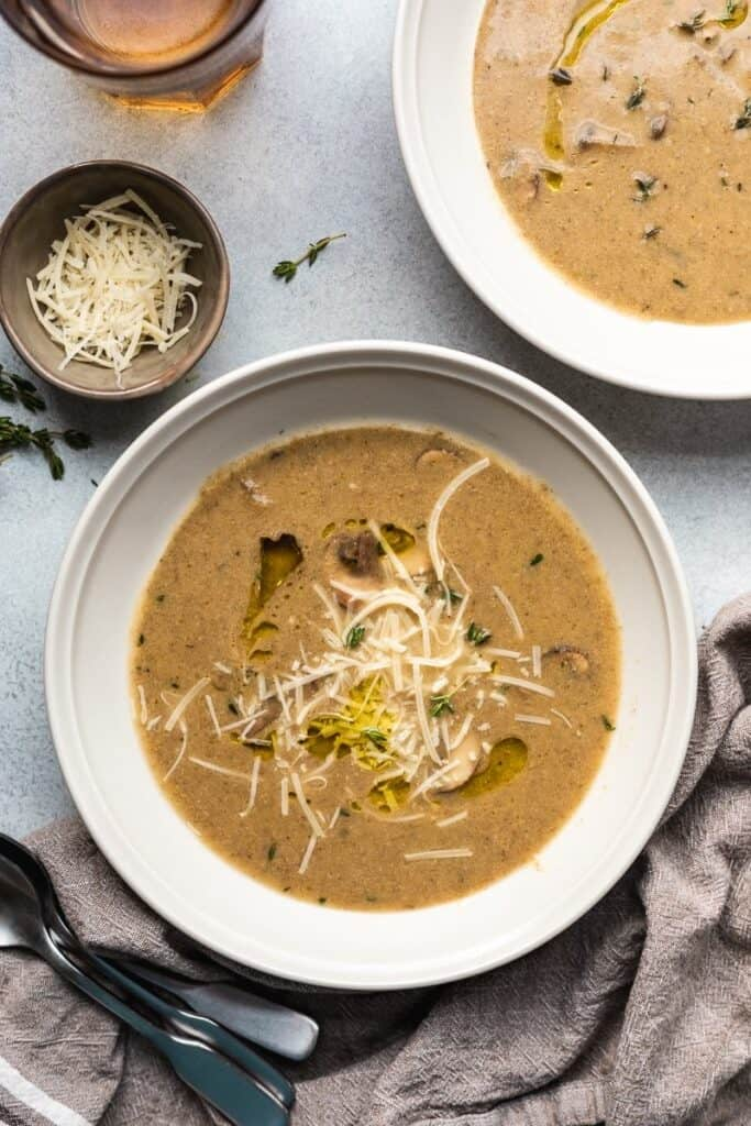 keto mushroom soup in a bowl with garnishes