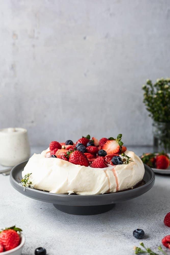 straight on shot of keto pavlova on a cake stand