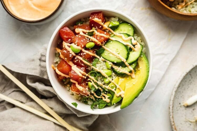 keto poke bowl with other dishes around it