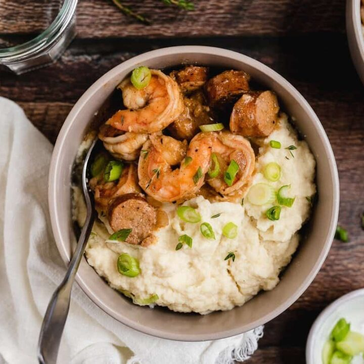 keto shrimp and grits with green onions in a bowl
